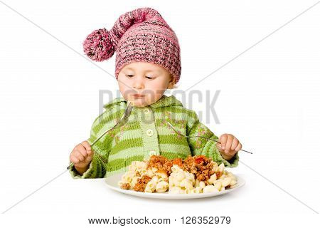 Cute child eating with two plugs, isolated over white