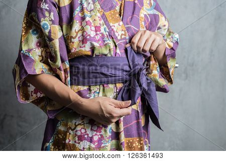 Onsen series : Unrecognizable woman tie obi yukata