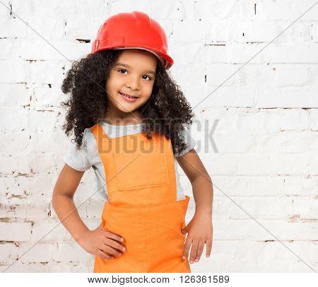 little girl in orange repairmen uniform