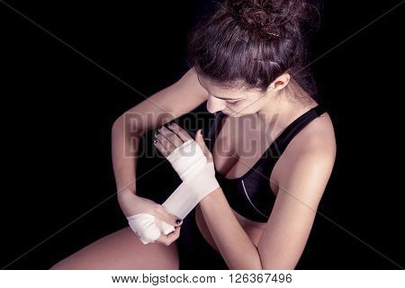 Young Kickboxer Rolls Up The Bandage Around His Hands
