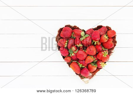 Fresh Strawberries In Plate On White Wooden Table. Top View, Copy Space. Strawberry Heart