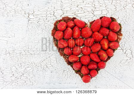 Fresh Strawberries In Plate On White Wooden Background. Top View, Copy Space. Strawberry Heart.