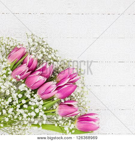 Pink Tulips And Gypsophila Flowers On White Tablecloth. Bouquet, Top View, Copy Space, Holiday Backg