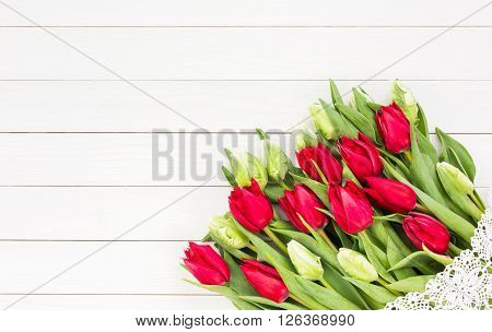 Red Tulips Bouquet Decorated With Lace On White Wooden Table. Copy Space, Top View