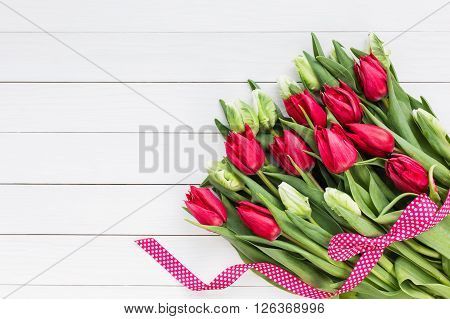 Bouquet Of Tulips On White Wooden Background.