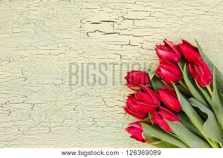 Bouquet Of Red Tulips On The Table. Top View, Copy Space