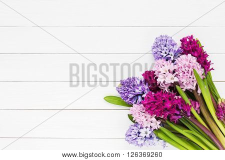 Bouquet Of Pink Hyacinth Flowers On White Wooden Background. Top View, Copy Space