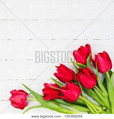 Red Tulips On White Tablecloth. Bouquet, Top View, Copy Space, Holiday Background