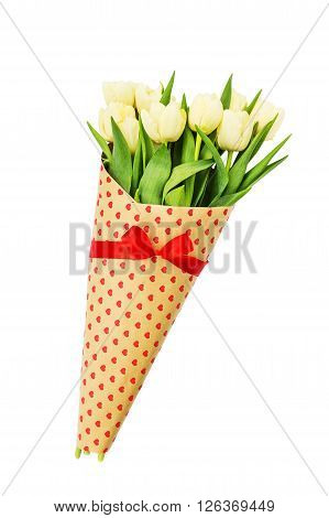 Bouquet Of Yellow Spring Tulips Wrapped In Paper With Hearts. Isolated Over White Background