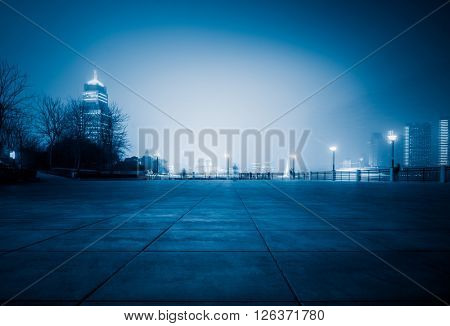 night city square,blue toned image.