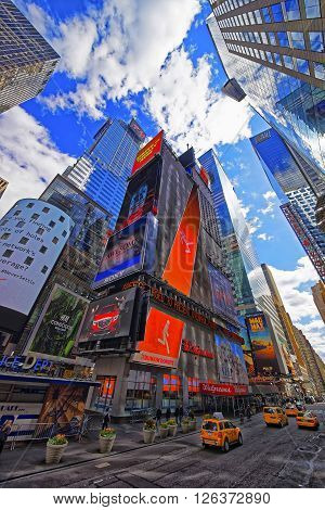 NEW YORK USA - APRIL 24 2015: Intersection of Broadway and West Street 42nd in Midtown Manhattan New York USA. It is Times Square. Tourists nearby