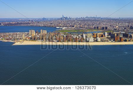 Helicopter view on Coney Island Beach and Boardwalk Brooklyn New York City USA. Washed by Coney Island Channel and Coney Island Creek. Lower Manhattan is far on the background