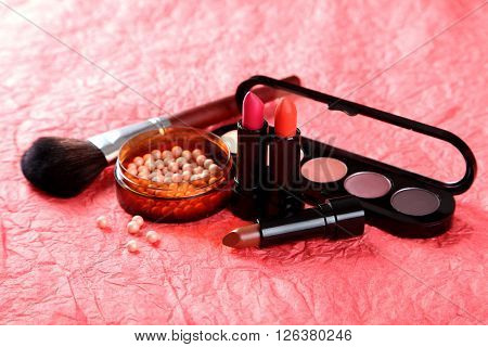 Makeup Brush And Cosmetics On A Red Background