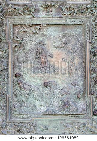 PISA, ITALY - JUNE 06: Agony in the Garden, artwork from the school of Giambologna, panel from the bronze door on the right of the Cathedral St. Mary of the Assumption in Pisa, Italy on June 06, 2015