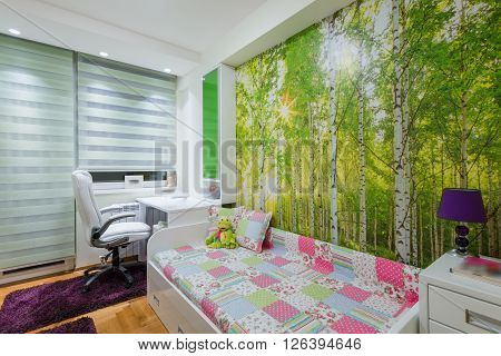 Children's room interior with wallpaper mural photo