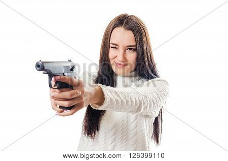 The beautiful woman shoots from the pistol