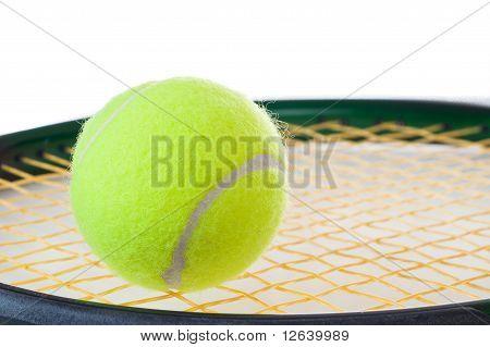 A Single Tennis Ball On A Tennis Racket