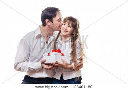 The father kisses the daughter on a cheek and thanks for a gift
