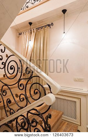 Staircase with wrought iron railings in luxury home interior