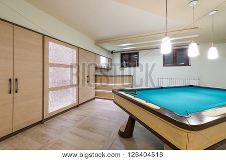 Entertainment room in luxury mansion with pool table
