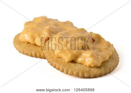 Pimento Cheese spread on Crackers isolated on white.