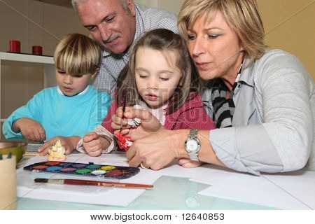 Children making watercolors with children