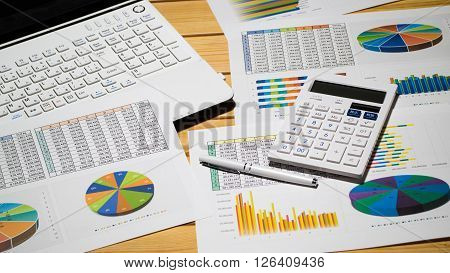 The image which is being analyzed using a PC,a calculatar and a chart.