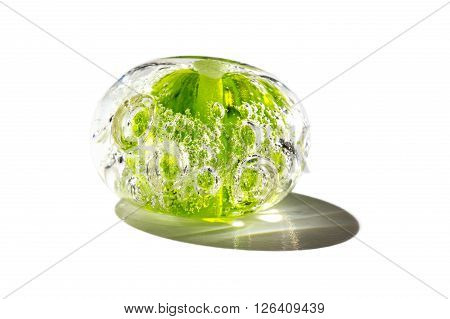 Hand made transparent green glass bead on white background