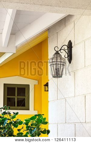 Front porch decor elements metal and glass pretty sconce mounted on the wall