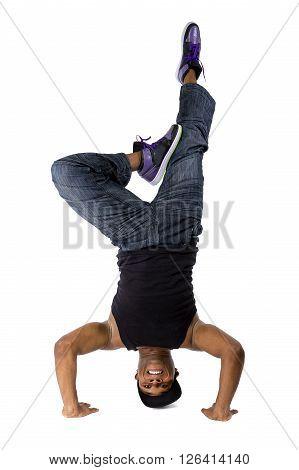 Hip hop breakdancer or dance workout instructor balancing upside down