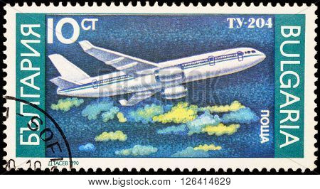 MOSCOW RUSSIA - APRIL 18 2016: A stamp printed in Bulgaria shows russian passenger aircraft Tupolev Tu-204 series