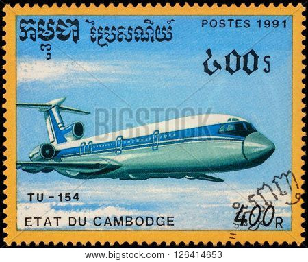 MOSCOW RUSSIA - APRIL 19 2016: A stamp printed in Cambodia shows russian passenger aircraft Tu-154 series