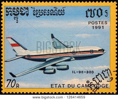 MOSCOW RUSSIA - APRIL 19 2016: A stamp printed in Cambodia shows russian passenger aircraft Ilyushin Il-96-300 series