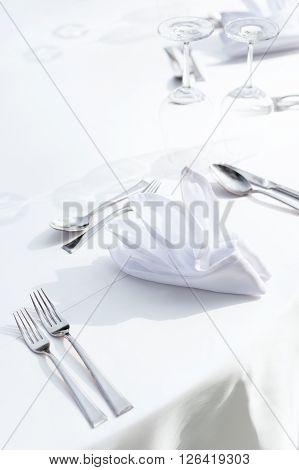 fine table setting white theme at beachside.