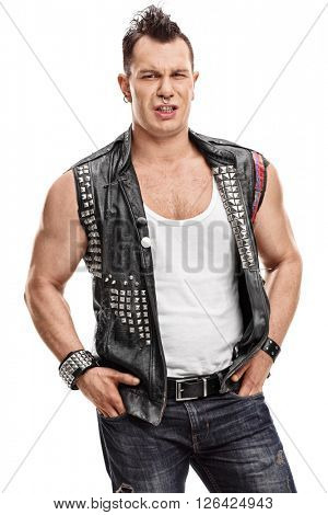 Vertical shot of a displeased punker with an old leather jacket with pins isolated on white background