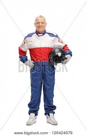 Full length portrait of a mature man in a racing suit holding a gray helmet isolated on white background