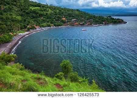 Clear tropical sea and green hills. East of Bali island (Amed)