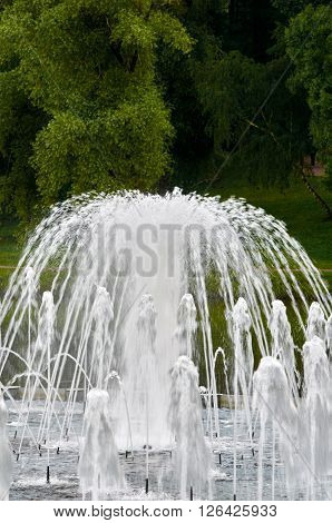part of fountain and space green trees in Tsaritsyno park. Moskow, Russia.
