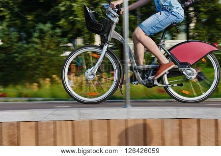 part of cyclist in motion on city background. Moskow Russia, Crimean embankment. about Park Muzeon Arts
