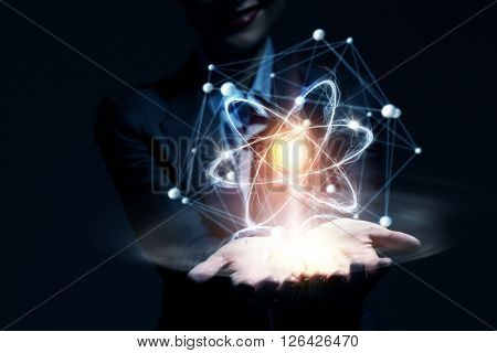 Atom molecule in female hand