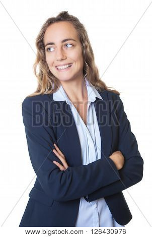 Blond businesswoman with blue eyes and blazer looking sideways on an isolated white background for cut out