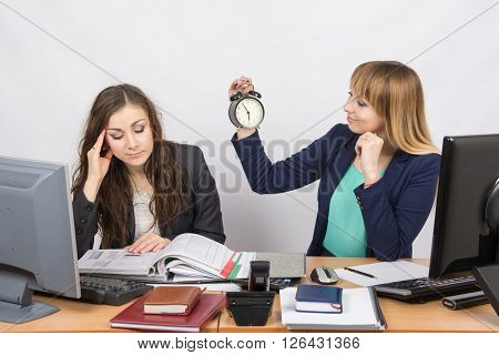 In The Office At The End Of The Working Day Is One Staff Member Would Look At The Clock And The Othe
