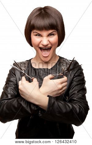 Picture of stylish crazy hairdresser screaming holding two scissors
