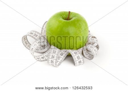 Picture of green apple and tape measure isolated on white