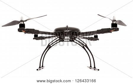 Black quadrocopter at studio isolated on white