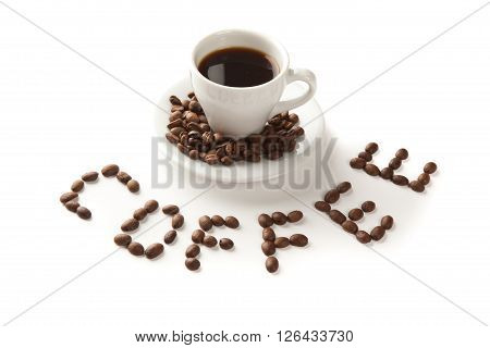 A cup of coffee and seeds isolated on white