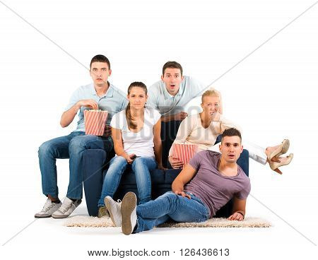 Young men and women sitting on a sofa. Anticipation. On white background