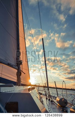 sail sailing ship on the water and the sky with clouds wih filter