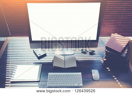 Mock up of home desktop with pc computer and digital tablet with blank copy space screen for your promotional content keyboard with mouse sunglasses little notepadbooks modern hipster work space