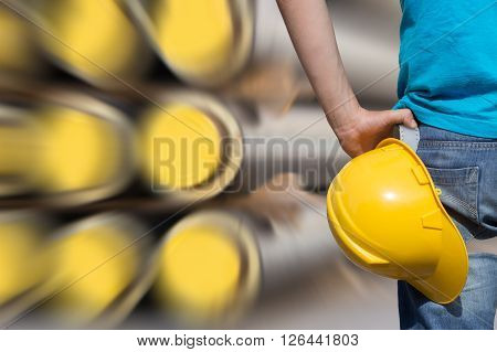 Construction worker ready for job on a pipeline.